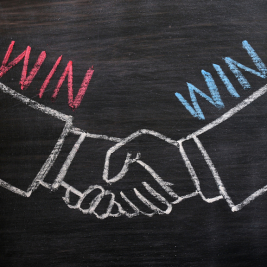 Mutual benefit concept of handshaking on blackboard
