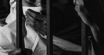 grayscale-photography-of-woman-inside-jail-2307045